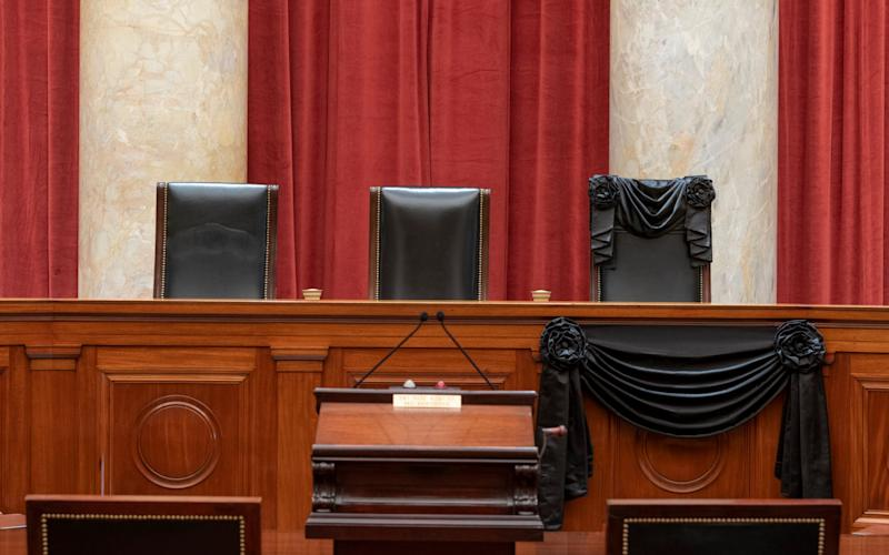 Justice Ruth Bader Ginsburg's chair is draped with black fabric - Fred Schilling/Collection of the Supreme Court of the United States via AP