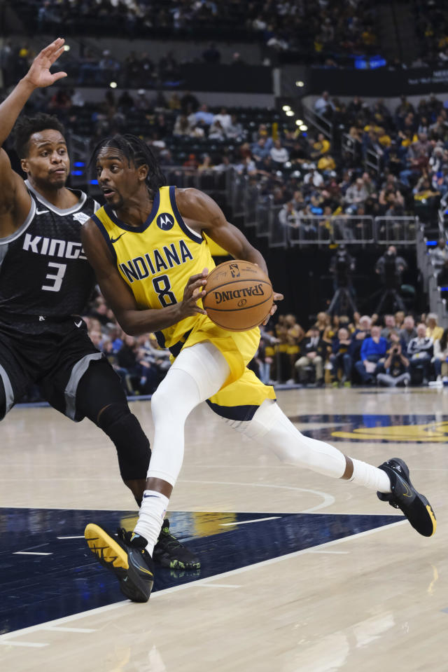 Indiana Pacers forward Justin Holiday (8) drives in front of Sacramento Kings guard Yogi Ferrell (3) during the second half of an NBA basketball game in Indianapolis, Friday, Dec. 20, 2019. The Pacers won 119-105. (AP Photo/AJ Mast)