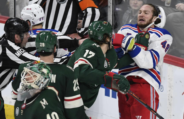Minnesota Wild's Marcus Foligno (17) throws a punch at New York Rangers' Brendan Lemieux, right, in the third period of an NHL hockey game Saturday, March 16, 2019, in St. Paul, Minn. Both players received penalties for roughing. The Wild beat the Rangers 5-2. (AP Photo/Tom Olmscheid)