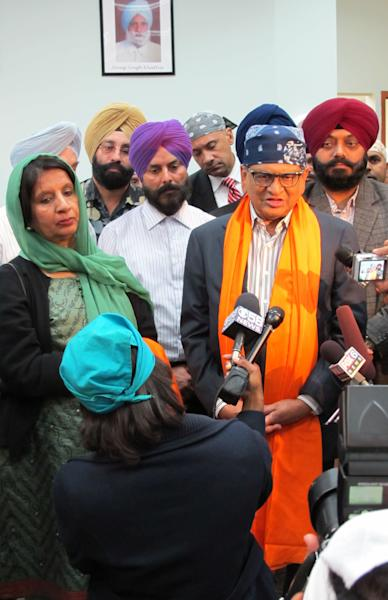 Nirupama Rao, India's ambassador to the United States, left, in green headscarf, and S.M. Krishna, India's external affairs minister, right, in orange saropa, address the media during a visit to the Sikh Temple of Wisconsin in suburban Milwaukee Thursday, Oct. 4, 2012 to express condolences after a mass shooting in August left six worshippers dead. (AP Photo/Todd Richmond)