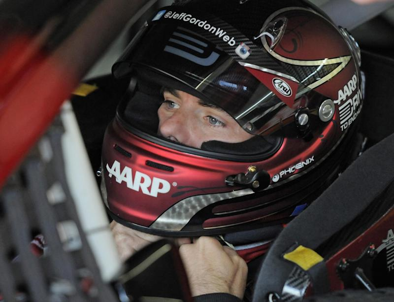 Jeff Gordon waits in his car before practice for Sunday's NASCAR Sprint Cup series Coca-Cola 600 auto race at Charlotte Motor Speedway in Concord, N.C., Saturday, May 24, 2014