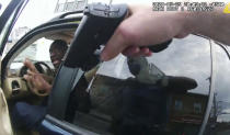 In this image from police body camera video George Floyd responds to police after they approached his car outside Cup Foods in Minneapolis, on May 25, 2020. The image was shown as prosecutor Steve Schleicher gave closing arguments while Hennepin County Judge Peter Cahill presided Monday, April 19, 2021, at the Hennepin County Courthouse in Minneapolis, in the trial of former Minneapolis police Officer Derek Chauvin, who is charged in the May 25 death of Floyd. (Court TV via AP, Pool)