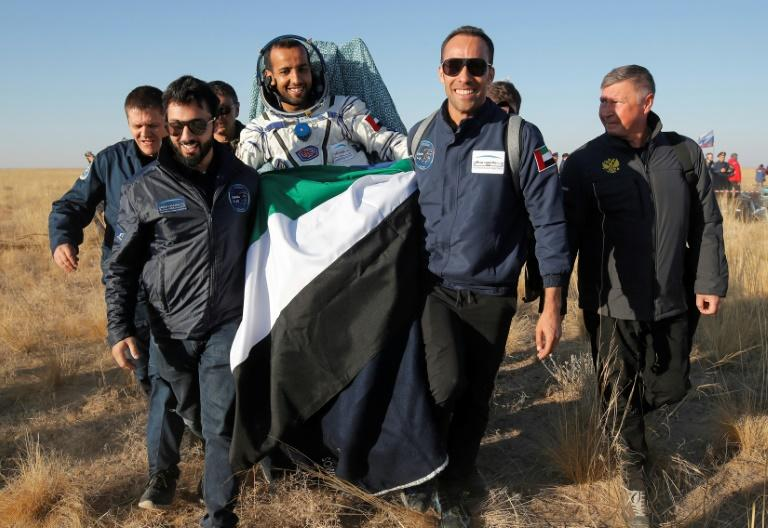 Emirati astronaut Hazzaa al-Mansoori is carried by a rescue team shortly after returning from space on October 3, 2019