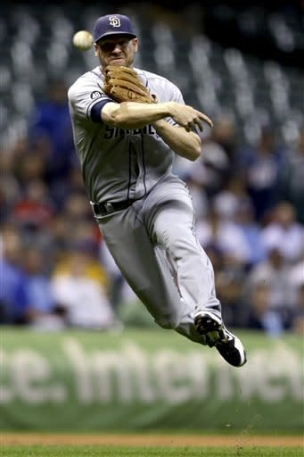 San Diego Padres' Chase Headley cannot throw out Milwaukee Brewers' Norichika Aoki on an infield hit during the first inning of a baseball game, Monday, Oct. 1, 2012, in Milwaukee. (AP Photo/Jeffrey Phelps)