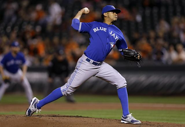 Toronto Blue Jays starting pitcher Esmil Rogers throws to the Baltimore Orioles in the first inning of a baseball game on Wednesday, Sept. 25, 2013, in Baltimore. (AP Photo/Patrick Semansky)