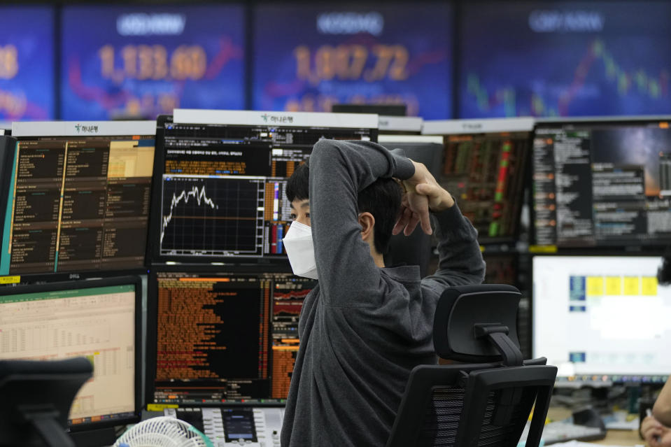A currency trader watches monitors at the foreign exchange dealing room of the KEB Hana Bank headquarters in Seoul, South Korea, Wednesday, June 23, 2021. Asian stock markets followed Wall Street higher on Wednesday after the Federal Reserve chairman said higher U.S. inflation probably is temporary, helping to calm fears central bankers might feel pressure to roll back economic stimulus. (AP Photo/Ahn Young-joon)