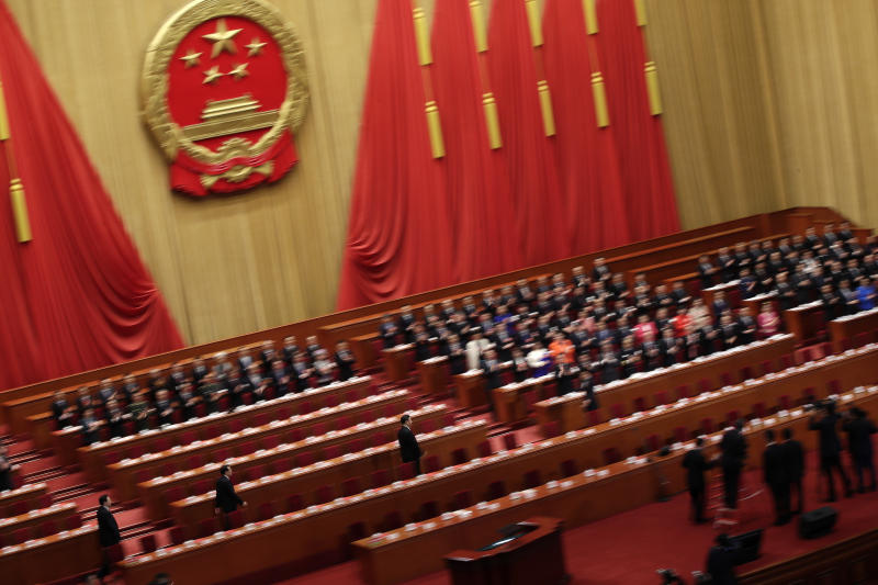 Chinese President Xi Jinping, center, is followed by Premier Li Keqiang and leaders as they arrive for the closing session of the annual National People's Congress (NPC) at the Great Hall of the People in Beijing, Tuesday, March 20, 2018. (AP Photo/Andy Wong)