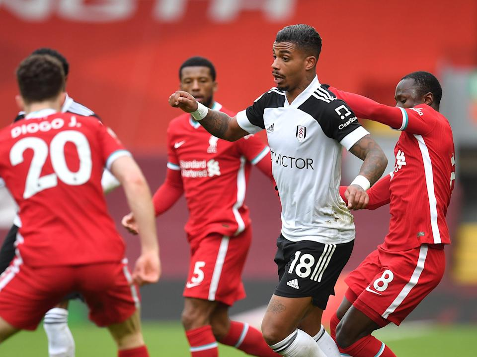 Fulham goalscorer Mario Lemina is surrounded by Liverpool players (Getty Images)