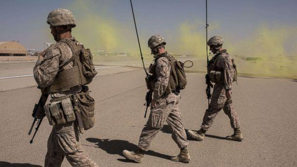 PHOTO: Members of the U.S. Marine Corp Task Force South West walk across a runway after marking a location for an airdrop of cargo on Sept. 10, 2017 at Camp Shorab in Helmand Province, Afghanistan. (Andrew Renneisen/Getty Images, FILE)