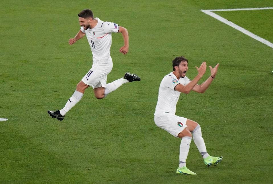 Italy's Domenico Berardi, left, and Manuel Locatelli celebrate after Turkey's Merih Demiral diverted the ball into his own net for the opening goal of Euro 2020 (AP)
