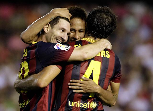 Barcelona's Lionel Messi (L) celebrates with teammates Neymar (C) and Cesc Fabregas after scoring against Valencia during their Spanish first division soccer match at the Mestalla Stadium in Valencia September 1, 2013. REUTERS/Heino Kalis (SPAIN - Tags: SPORT SOCCER)