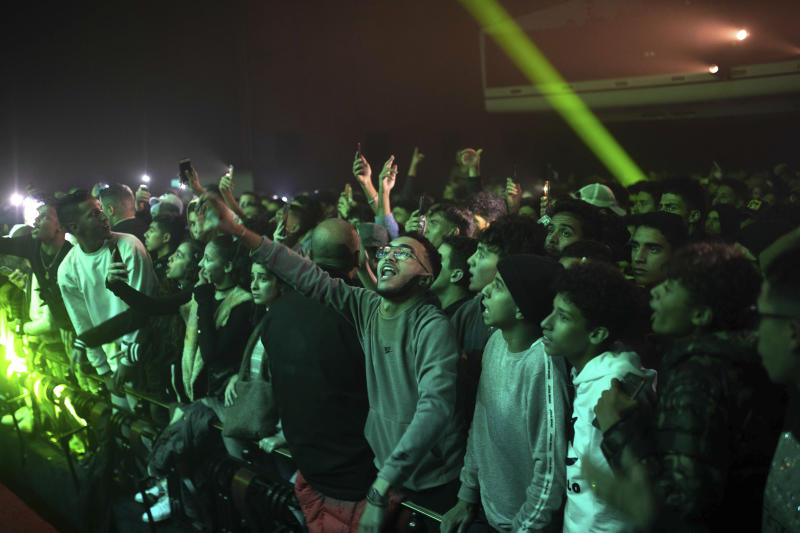 In this Friday, Nov. 22, 2019 photo, rap music fans attend a concert for Moroccan rappers as part of the Visa for Music festival in Rabat, Morocco. (AP Photo/Mosa'ab Elshamy)