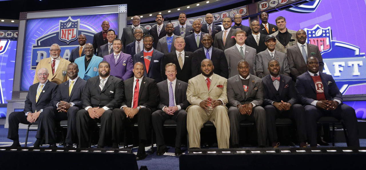 Former NFL players representing all 32 teams in the league gather on stage before the start of the second round of the 2014 NFL Draft, Friday, May 9, 2014, in New York. (AP Photo/Jason Decrow)