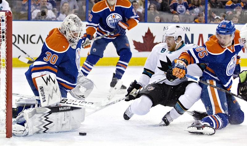 San Jose Sharks Joe Pavelski (8) is stopped by Edmonton Oilers goalie Ben Scrivens (30) as Martin Marincin (85) tries to defend during the first period of an NHL hockey game in Edmonton, Alberta, on Wednesday, Jan. 29, 2014. (AP Photo/The Canadian Press, Jason Franson)