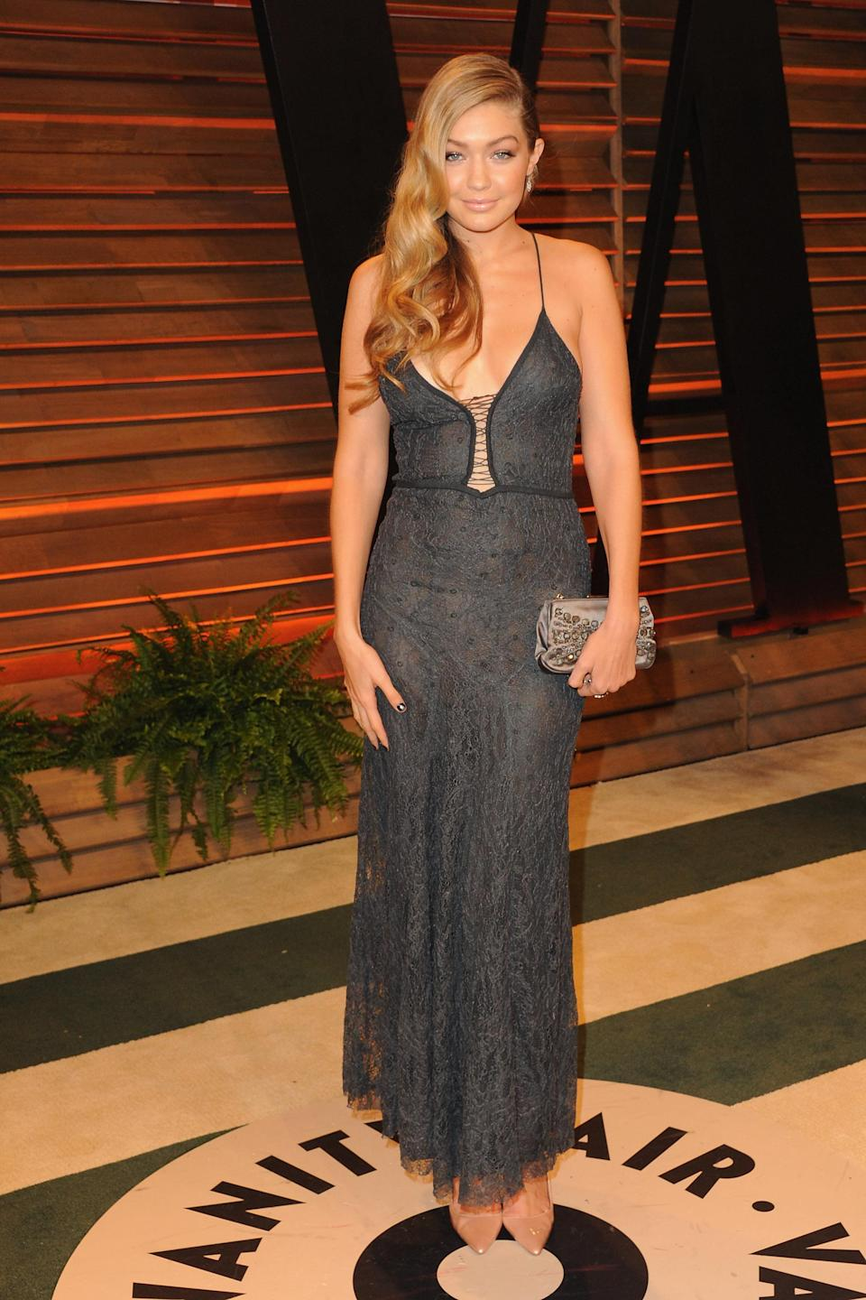 This gray, lacy dress on Hadid at the 2014 Oscars after-party is simply stunning.