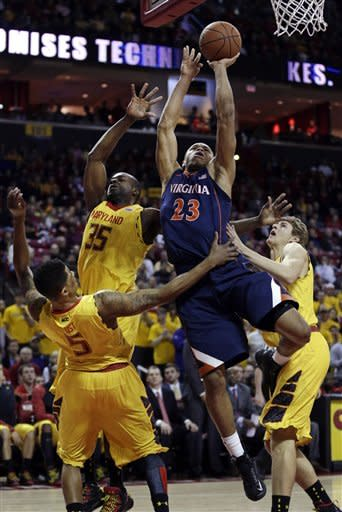 Virginia guard Justin Anderson (23) shoots over, from left to right, Maryland's Nick Faust, James Padgett and Jake Layman in the first half of an NCAA college basketball game in College Park, Md., Sunday, Feb. 10, 2013. (AP Photo/Patrick Semansky)