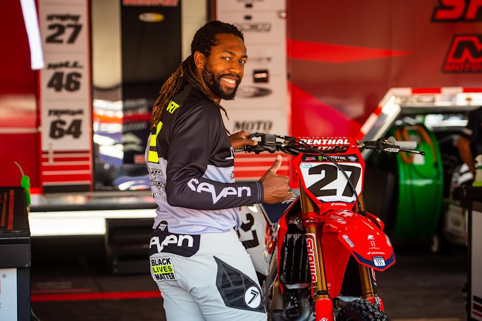 <em>Malcolm Stewart gives a thumbs up before finishing fifth at the June 14 Supercross event in Salt Lake City (Feld Entertainment).</em>