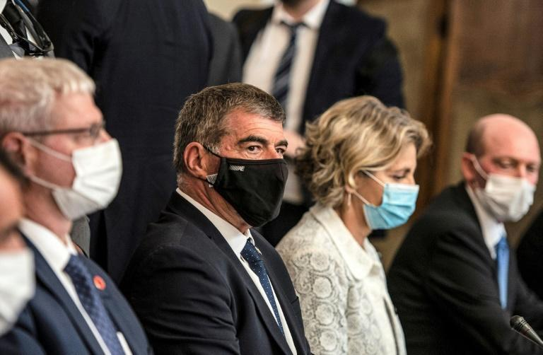 Israel's Foreign Minister Gabi Ashkenazi, wearing a black facemask, at Tahrir Palace in Egypt's capital Cairo