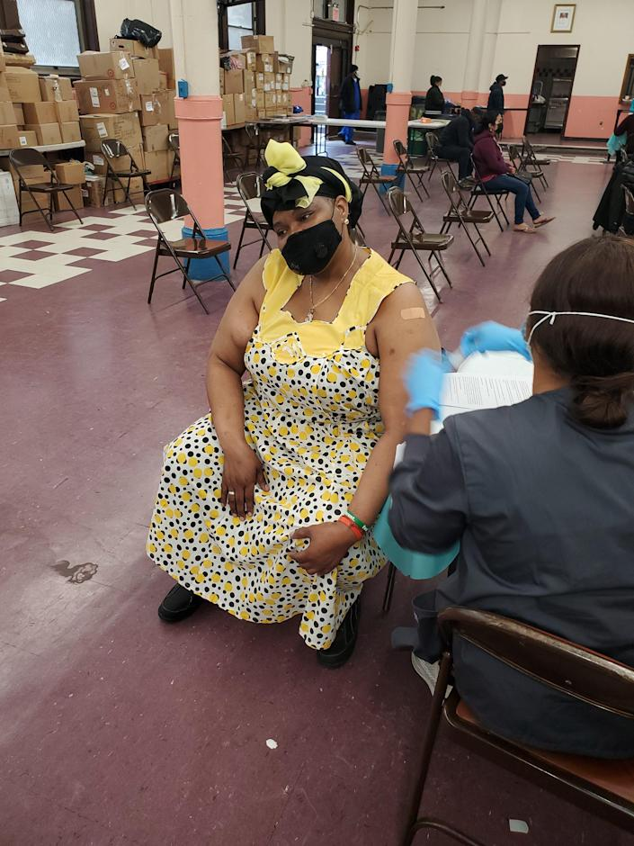 During a Bronx, New York vaccine event by Afro-Central American cultural center Casa Yurumein, a worker injects Ivett Suazo David, who is of the Afro-Indigenous ethnic group, the Garífuna of Central America.