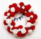"""<p>Red-and-white pom poms, blue wood stars, and a tiny pennant give this patriotic wreath a playful twist. </p><p><strong>Get the tutorial at <a href=""""https://flamingotoes.com/patriotic-pom-pom-wreath/"""" rel=""""nofollow noopener"""" target=""""_blank"""" data-ylk=""""slk:Flamingo Toes"""" class=""""link rapid-noclick-resp"""">Flamingo Toes</a>. </strong></p><p><strong><a class=""""link rapid-noclick-resp"""" href=""""https://www.amazon.com/Maker-Sizes-Pompom-Knitting-Project/dp/B07KYJGS2M/ref=sr_1_2?dchild=1&keywords=pom+pom+maker&qid=1622036870&sr=8-2&tag=syn-yahoo-20&ascsubtag=%5Bartid%7C10050.g.4464%5Bsrc%7Cyahoo-us"""" rel=""""nofollow noopener"""" target=""""_blank"""" data-ylk=""""slk:SHOP POM POM MAKER"""">SHOP POM POM MAKER</a><br></strong></p>"""