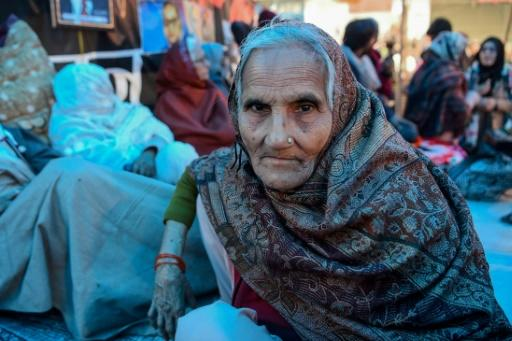 For nearly four weeks, Noornissa and more than 200 other women have sat and slept across the four-lane road