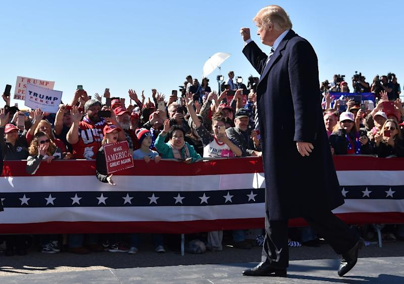 US President Donald Trump greets supports at rally in Elko, Nevada on October 20, 2018 (AFP Photo/Nicholas Kamm)