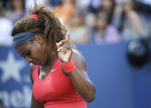 Serena Williams reacts after a point to Victoria Azarenka, of Belarus, during the women's singles final of the 2013 U.S. Open tennis tournament, Sunday, Sept. 8, 2013, in New York. (AP Photo/David Goldman)