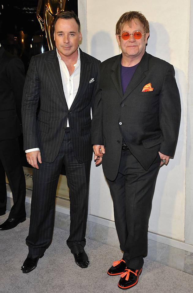David Furnish and musician Sir Elton John attend Tom Ford's cocktail event in support of Project Angel Food at TOM FORD on February 21, 2013 in Beverly Hills, California.