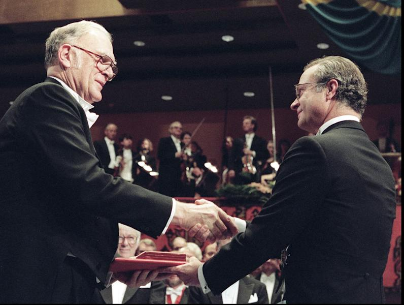 FILE - In this Dec. 10, 1995 file photo, American professor F. Sherwood Rowland, left, receives the Nobel prize for chemistry from Swedish King Carl XVI Gustaf, right, at the Concert Hall in Stockholm, Sweden. Rowland, the chemist who sounded the alarm on the depletion of Earth's ozone layer, died Saturday, March 10, 2012, at his home in Corona Del Mar, Calif. at age 84. He was among three scientists awarded the 1995 Nobel Prize for chemistry for discovering that a byproduct of aerosol sprays, deodorants and other consumer products could destroy the earth's atmospheric blanket. (AP Photo/Eric Roxfelt, File)