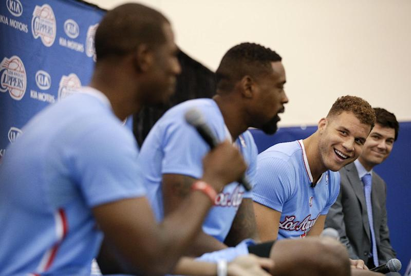 Los Angeles Clippers' Blake Griffin, right, with DeAndre Jordan, center, watches teammate Chris Paul answer a question during the team's NBA basketball media day on Monday, Sept. 30, 2013, in Los Angeles. (AP Photo/Jae C. Hong)
