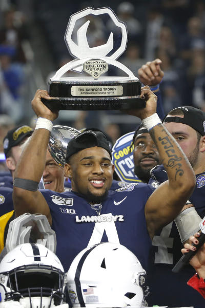 Penn State running back Journey Brown (4) celebrates following the team's 53-39 win over Memphis in an NCAA Cotton Bowl college football game, Saturday, Dec. 28, 2019, in Arlington, Texas. (AP Photo/Ron Jenkins)