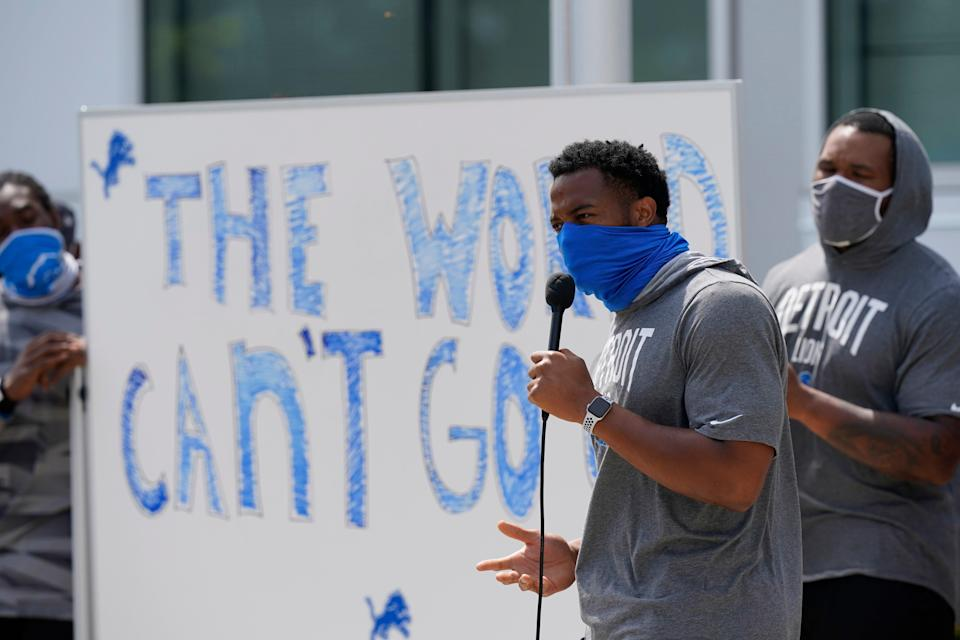 Detroit Lions defensive end Trey Flowers addresses the media with his teammates outside the Lions NFL football camp practice facility, Tuesday, Aug. 25, 2020, in Allen Park, Mich. The players were reacting to the recent shooting of Jacob Blake in Kenosha, Wis., on Sunday. (AP Photo/Carlos Osorio)