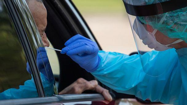 PHOTO: A health care worker uses a swab to test a man for COVID-19 at a drive-in testing location in Houston, Texas, on Aug. 18, 2020. (Adrees Latif/Reuters)
