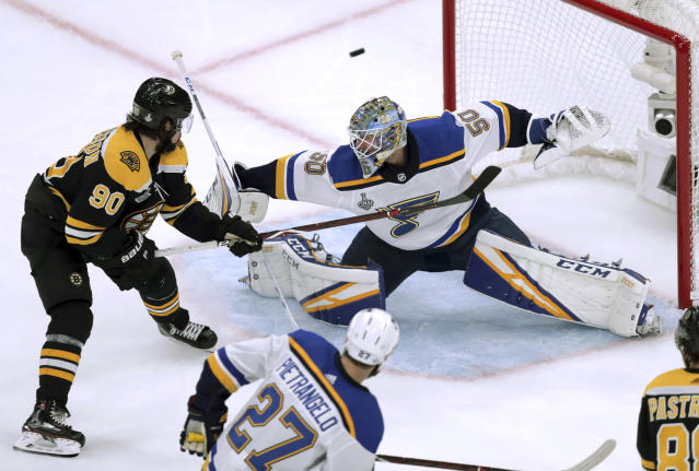St. Louis Blues goaltender Jordan Binnington, right, turns the puck aside in front of Boston Bruins' Marcus Johansson, left, of Sweden, during the first period in Game 7 of the NHL hockey Stanley Cup Final, Wednesday, June 12, 2019, in Boston. (AP Photo/Charles Krupa)