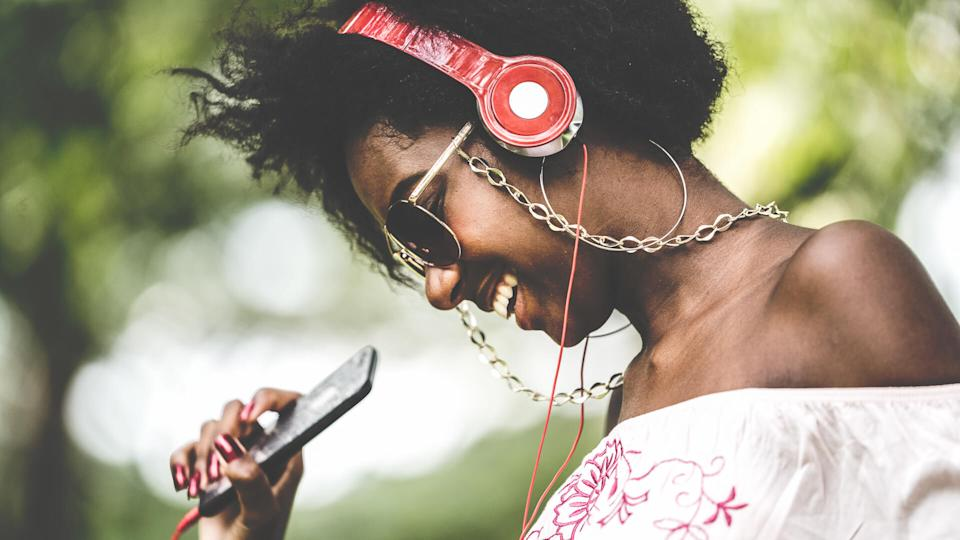 woman listening to Spotify music with headphones