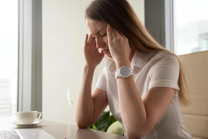 Businesswoman tries to cope with nervous tension or anxiety
