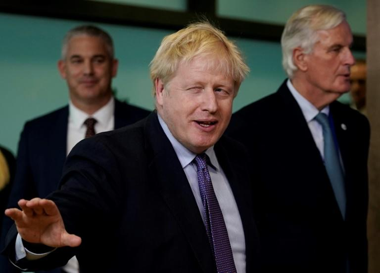 British Prime Minister Boris Johnson will require backing from hardcore eurosceptics in his own Conservative Party, anti-no deal MPs he expelled from the Tory ranks, and opposition Labour rebels (AFP Photo/Kenzo TRIBOUILLARD)