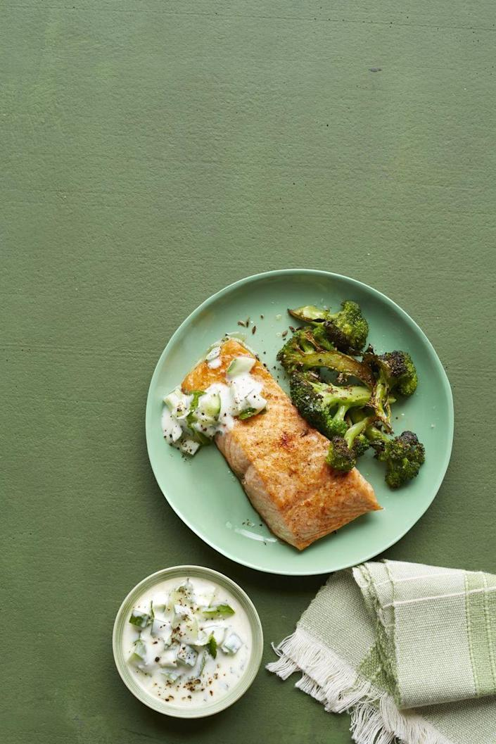 """<p>An unbelievably flavorful version of the stereotypical healthy meal of salmon and broccoli — but this time with a zesty yogurt sauce.</p><p><em><a href=""""https://www.womansday.com/food-recipes/food-drinks/recipes/a57716/salmon-yogurt-sauce-roasted-broccoli-recipe/"""" rel=""""nofollow noopener"""" target=""""_blank"""" data-ylk=""""slk:Get the Spicy Salmon with Yogurt Sauce and Roasted Broccoli recipe."""" class=""""link rapid-noclick-resp"""">Get the Spicy Salmon with Yogurt Sauce and Roasted Broccoli recipe.</a></em></p>"""