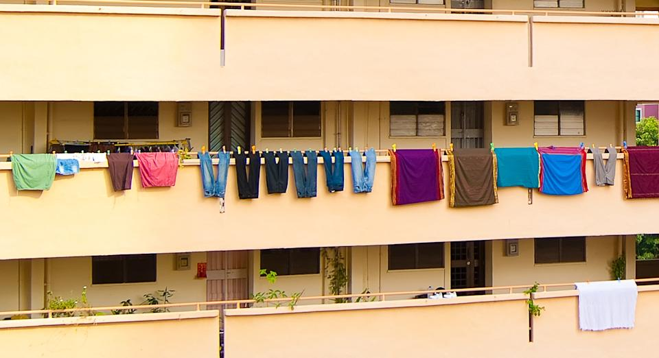 Laundry at a corridor of an HDB block. (FILE PHOTO: Getty Images)