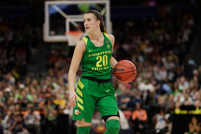 Oregon guard Sabrina Ionescu (20) dribbles the ball, during a women's Final Four NCAA college basketball semifinal tournament game against Baylor, Friday, April 5, 2019, in Tampa, Fla. (AP Photo/Chris O'Meara)