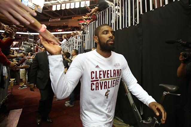 "<a class=""link rapid-noclick-resp"" href=""/nba/players/4840/"" data-ylk=""slk:Kyrie Irving"">Kyrie Irving</a> high-fives Cavaliers fans after Game 4 of the 2017 NBA Finals, which would be his final home game in Cleveland. (Getty)"