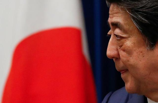 Japan's Prime Minister Shinzo Abe attends a news conference on Japan's response to the coronavirus outbreak at his official residence in Tokyo