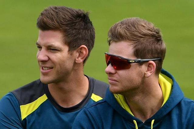 He'll be right - Australia captain Tim Paine (L) believes Steve Smith's (R) batting confidence will remain intact after he was concussed by a Jofra Archer bouncer and Australia's Steve Smith watch teammates during a practice session at Headingley Stadium in Leeds, northern England, on August 21, 2019 on the eve of the start of the third Ashes cricket Test match between England and Australia. (AFP Photo/Paul ELLIS)