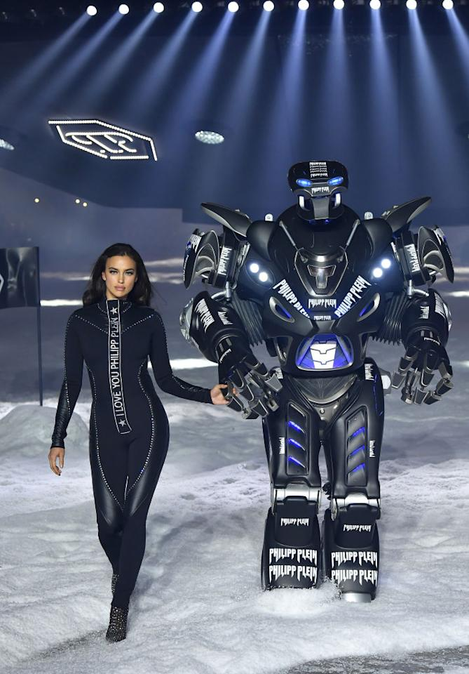 <p>Irina Shayk walks hand-in-hand with Philipp Plein's Transformers robot. (Photo: Getty) </p>