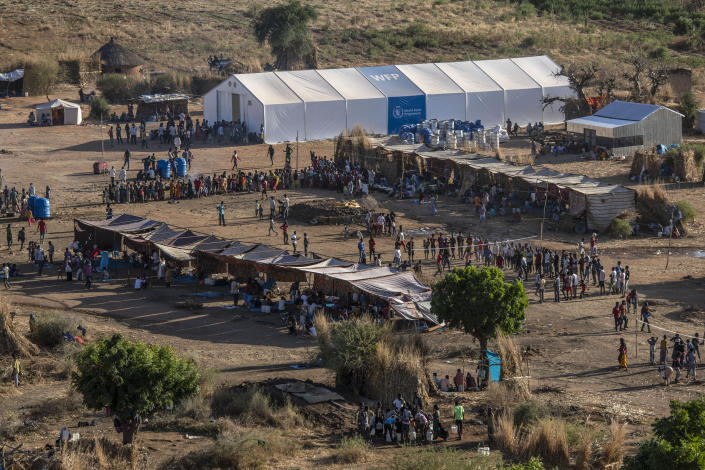 A general view of Um Rakuba refugee camp in Qadarif, eastern Sudan, Monday, Nov. 23, 2020. Tens of thousands of people have fled a conflict in Ethiopia for Sudan, sometimes so quickly they had to leave family behind. There is not enough to feed them in the remote area of southern Sudan that they rushed to. (AP Photo/Nariman El-Mofty)