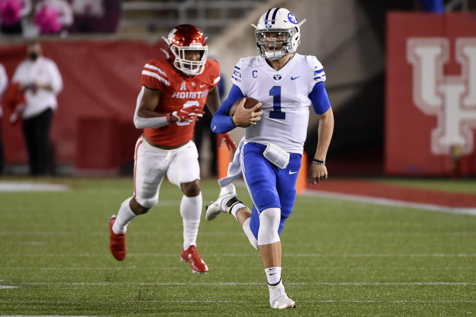 BYU quarterback Zach Wilson, right, runs past Houston safety JoVanni Stewart during the first half of an NCAA college football game, Friday, Oct. 16, 2020, in Houston. (AP Photo/Eric Christian Smith)