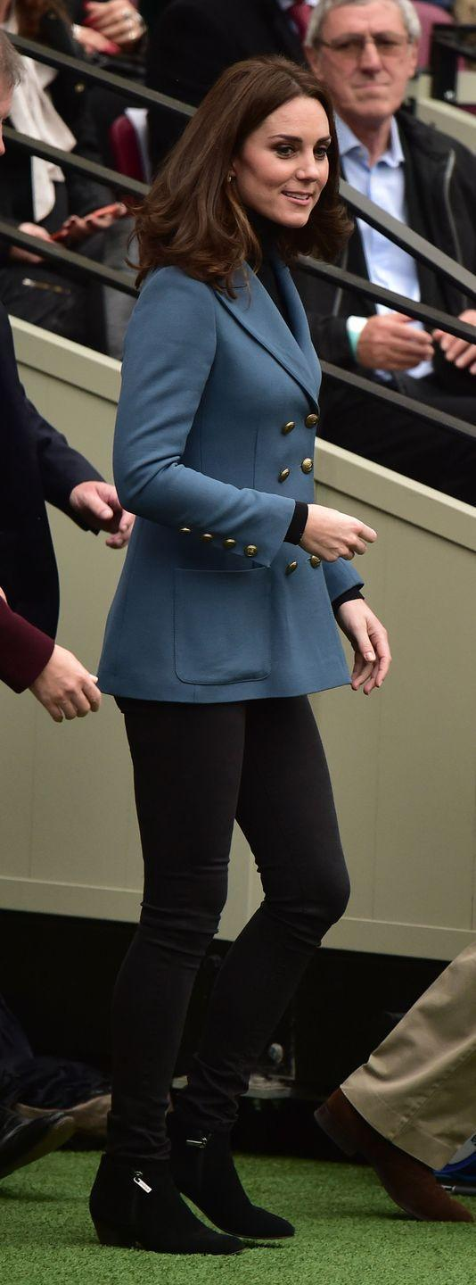 """<p>Duchess Kate <a href=""""https://www.townandcountrymag.com/society/tradition/a13043694/kate-middleton-surprise-pregnancy-appearance/"""" rel=""""nofollow noopener"""" target=""""_blank"""" data-ylk=""""slk:made yet another surprise appearance"""" class=""""link rapid-noclick-resp"""">made yet another surprise appearance</a> at the Coach Core graduation celebration at the London Stadium wearing an appropriately sporty look. The Duchess paired a blue blazer <a href=""""https://twitter.com/WhatKateWore/status/920649233681780737"""" rel=""""nofollow noopener"""" target=""""_blank"""" data-ylk=""""slk:by Philosophy"""" class=""""link rapid-noclick-resp"""">by Philosophy</a> with black pants and black booties, along with a pair of diamond leaf earrings by <a href=""""https://twitter.com/PackhamGown/status/920648623913947136"""" rel=""""nofollow noopener"""" target=""""_blank"""" data-ylk=""""slk:Kiki McDonough"""" class=""""link rapid-noclick-resp"""">Kiki McDonough</a>.</p><p><strong>More</strong>: <a href=""""https://www.townandcountrymag.com/style/fashion-trends/g10344923/kate-middleton-favorite-fashion-brands-designers/"""" rel=""""nofollow noopener"""" target=""""_blank"""" data-ylk=""""slk:Kate Middleton's Favorite Fashion Brands to Wear"""" class=""""link rapid-noclick-resp"""">Kate Middleton's Favorite Fashion Brands to Wear</a><br></p>"""