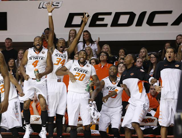 Oklahoma State players celebrate on the bench in the second half of an NCAA college basketball game against Mississippi Valley State in Stillwater, Okla., Friday, Nov. 8, 2013. Oklahoma State won 117-62. From left are Brian Williams (4), Gary Gaskins (34), Michael Cobbins (20), Marcus Smart (33), Kamari Murphy (21) and Jeffrey Carroll (30). (AP Photo/Sue Ogrocki)