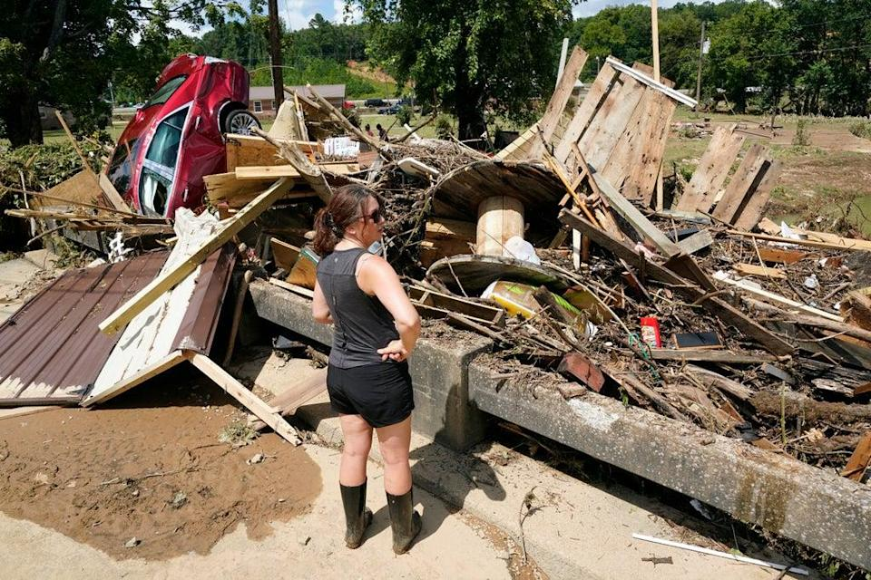 Survivors survey the damage in Tennessee after historic floods devastated the state (AP)