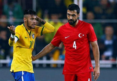 FILE PHOTO: Bekir Irtegun of Turkey (R) conforts Neymar of Brazil (L) after a foul during their international friendly soccer match against Turkey at Sukru Saracoglu stadium in Istanbul November 12, 2014. REUTERS/Murad Sezer/File Photo